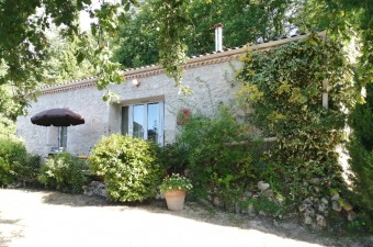 Renovated stone property of 2 houses, a pigeonnier, swimming pool and outbuildings on 8ha of land